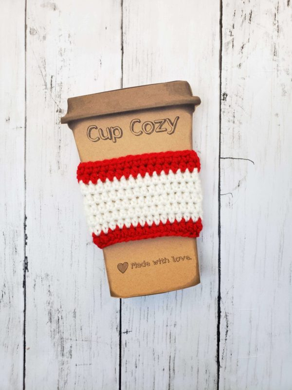 red and white coffee cup cozy