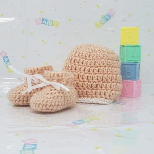 Peach newborn booties and hat set