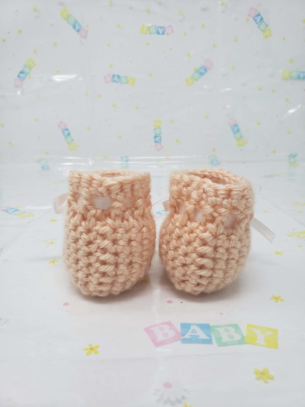 Peach newborn booties