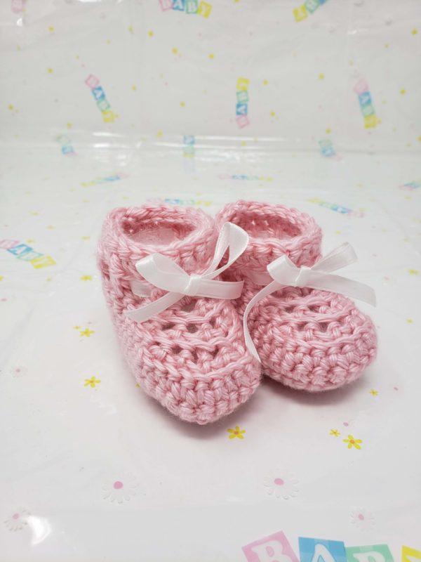 Pink newborn booties