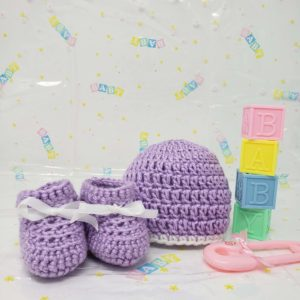 Purple newborn booties and hat set