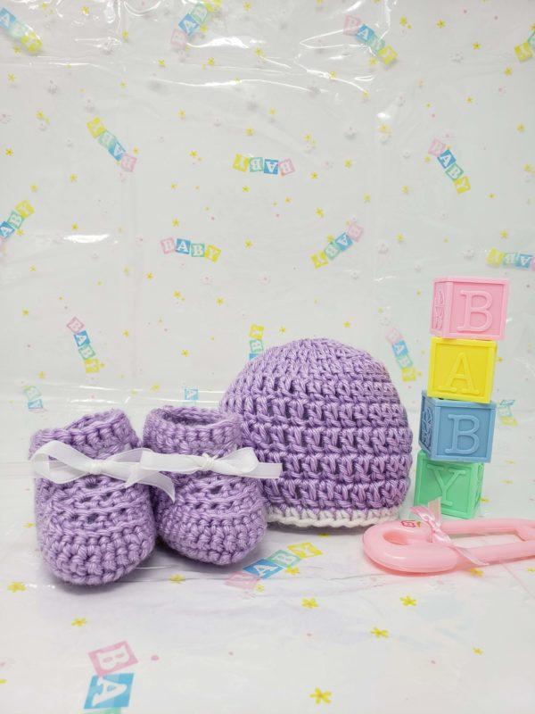 Purple newborn booties and hat set