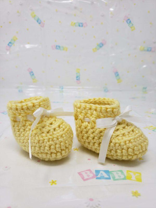 Yellow newborn booties