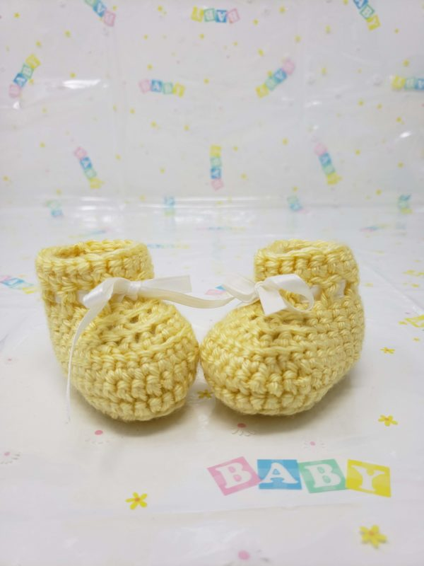 Yellow newborn booties
