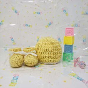 Yellow newborn booties and hat set