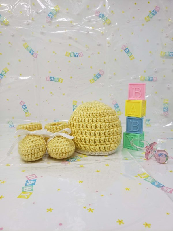 Yellow newborn booties and hat set
